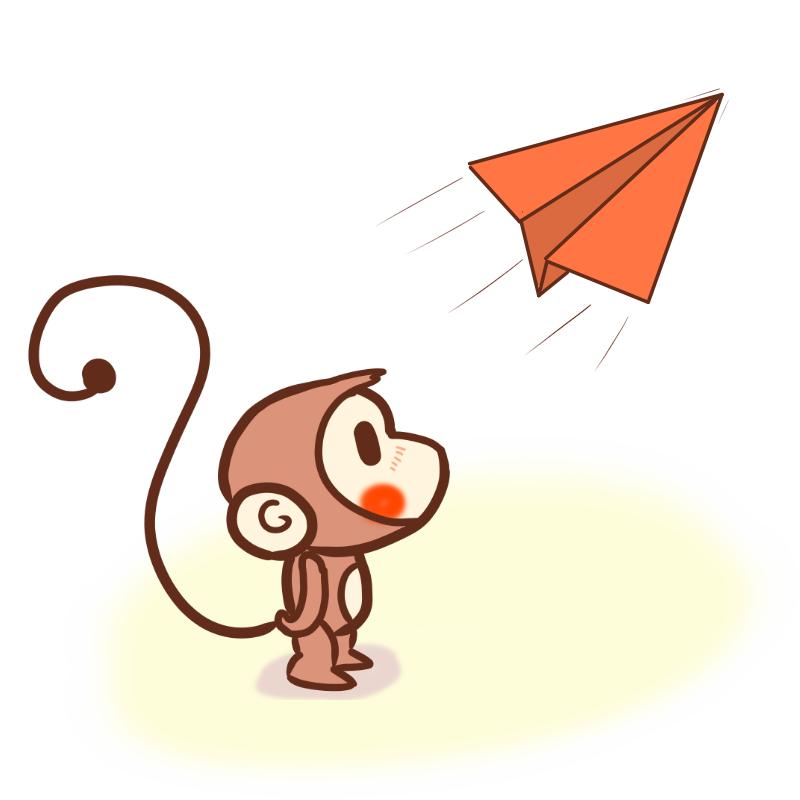 紙飛行機を眺めるサル